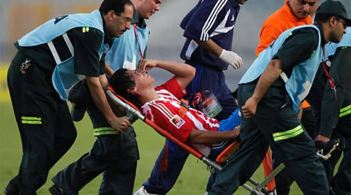 A soccer player is stretchered off the field